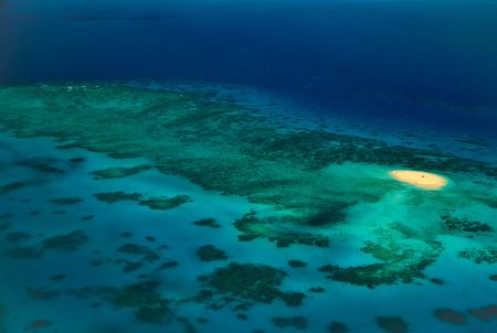 barrier: Aerial View of Upolu Cay Great Barrier Reef at Sunrise Stock Photo
