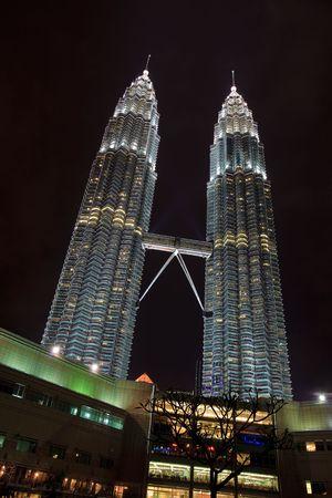 Illuminated Towers and Skywalk Shine Brightly Against Dark Night Sky