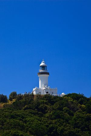 View of Byron Bay Lighthouse from Footpath on a Sunny Day photo
