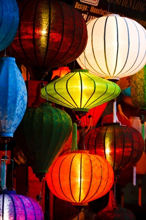 Silk lanterns glowing in a street market at night Stock Photo - 9925292