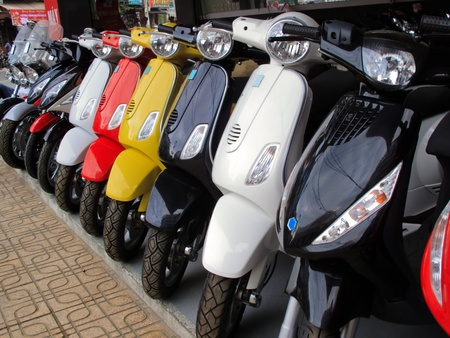 Closeup of the Front of a Row of Moped Motorcycles