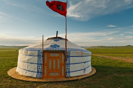 Traditional ger tent home of Mongolian nomads on the grass plains of the steppe