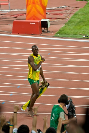 Beijing, China - Aug 16, 2008: Olympic Champion Sprinter Usain Bolt after victory in 100 meter Olympic race Editorial