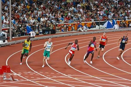 deportes olimpicos: Beijing, China-ago 18,2008: Carrera de velocistas olímpicos en 220 metros hombres