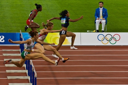 Beijing, China Olympics - Aug 18, 2008: Female Athletes competing in 100 meter sprint for women Stock Photo - 9891443