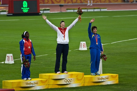 summer olympics: Beijing, China Olympics, Aug 18, 2008: Stephanie Trafton Brown, USA, receives the discus throw gold medal for women Editorial