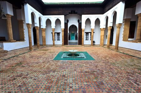 Meknes, Morocco: Interior of tiled courtyard with fountain of madrasah in Muslim school in Meknes, Morocco.