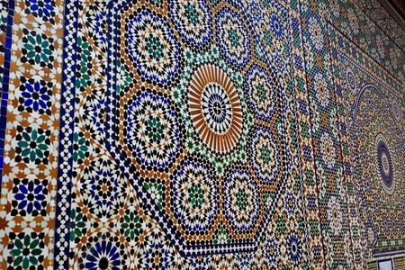 Meknes, Morocco: Ornate geometric mosaic tile work on mosque wall in Meknes, Morocco. Editorial