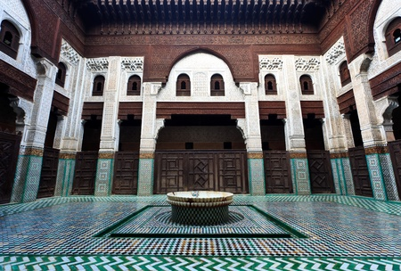 Meknes, Morocco: Intricate and symetrical mosaic tiled interior courtyard of Muslim madrasah school in Meknes, Morocco. Editorial