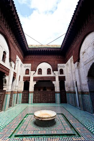 Meknes, Morocco: Interior courtyard with fountain of madrasah Muslim school in Meknes, Morocco.