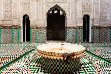 Meknes, Morocco: Interior courtyard with closeup of fountain of madrasah Muslim school in Meknes, Morocco.