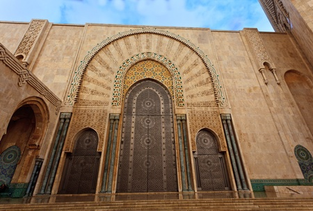 Casablanca, Morocco:  Ornate exterior brass door of Hassan II Mosque in Casablanca, Morocco.