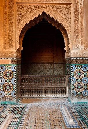Marrakesh, Morocco:  Detail of an ornate stone alcove inside a mosque in Marrakesh, Morocco.