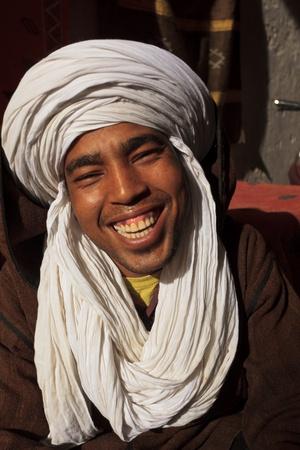 berber: Essaouira, Morocco - Jan 13: Portrait of smiling Berber man with white turban head garb, January 13, 2010 Essaouira, Morocco.