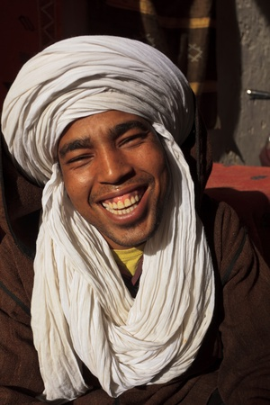 Essaouira, Morocco - Jan 13: Portrait of smiling Berber man with white turban head garb, January 13, 2010 Essaouira, Morocco.