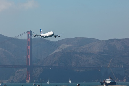SAN FRANCISCO, CALIFORNIA, USA - October 7, 2011: 747 jumbo jet flies low over the Golden Gate Bridge and San Francisco Bay during Fleet Week SAN FRANCISCO, CALIFORNIA, USA on October 7, 2011.