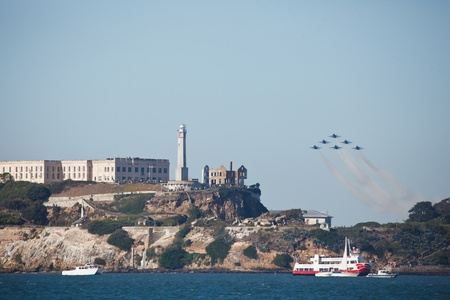 SAN FRANCISCO, CALIFORNIA, USA - October 7, 2011: navy jets perform an acrobatic airshow over Alcatraz Island and San Francisco Bay during Fleet Week in San Francisco, California on October 7, 2011.