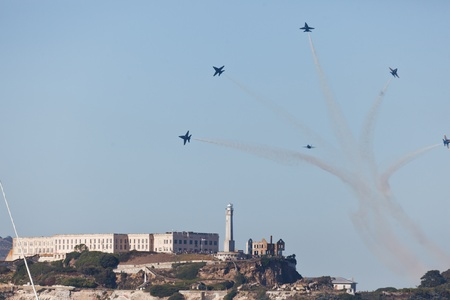 SAN FRANCISCO, CALIFORNIA, USA - October 7, 2011: navy jets perform an acrobatic airshow over Alcatraz Island and San Francisco Bay during Fleet Week on October 7, 2011 in San Francisco, USA