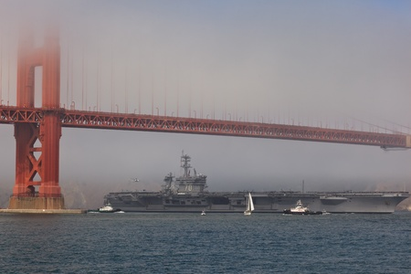 SAN FRANCISCO, CALIFORNIA, USA - October 8, 2011: Aircraft carrier USS Carl Vinson passes under the Golden Gate Bridge during Fleet Week on October 8, 2011 in San Francisco, USA Editorial