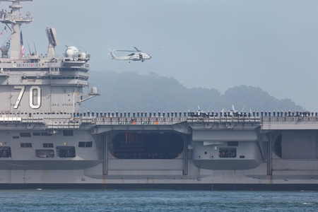 SAN FRANCISCO, CALIFORNIA, USA - OCTOBER 8, 2011: Detail of the flight deck of Aircraft carrier USS Carl Vinson and hovering helicopter during Fleet Week on October 8, 2011 in San Francisco, USA Editorial
