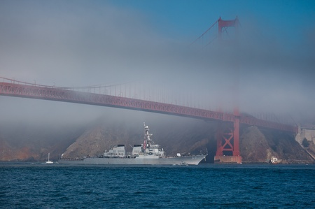 SAN FRANCISCO, CALIFORNIA, USA - October 8, 2011: USS Milius passes under the Golden Gate Bridge during Fleet Week on October 8, 2011 in San Francisco, USA