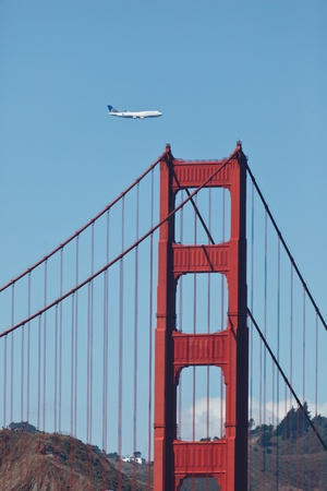 SAN FRANCISCO - October 7: 747 jumbo jet flies low over the Golden Gate Bridge and San Francisco Bay during Fleet Week on October 7, 2011 in San Francisco, USA