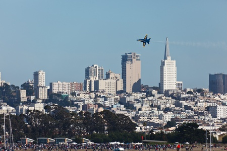 SAN FRANCISCO, CALIFORNIA, USA - October 9, 2011: City Skyline with Jet Flying Overhead during Fleet Week Air Show October 9, 2011 in San Francisco Editorial