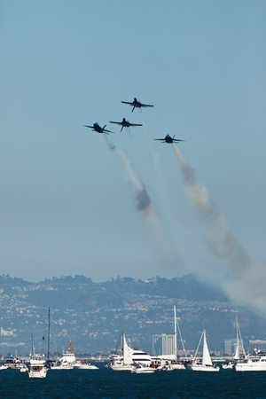 SAN FRANCISCO, CALIFORNIA, USA - October 9, 2011: 4 Planes fly over boats in San Francisco Bay in formation during Fleet Week Airshow on October 9, 2011  Editorial