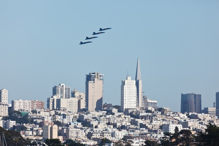 SAN FRANCISCO, CALIFORNIA, USA - October 9, 2011: Formation of 4 Planes fly over skyscrapers in city of San Francisco during Fleet Week Airshow in SAN FRANCISCO, CA, USA on October 9, 2011.