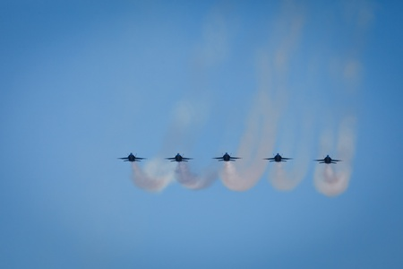 SAN FRANCISCO, CALIFORNIA, USA - October 9, 2011: Formation of 5 Planes fly over city of San Francisco during Fleet Week Airshow leaving trail of red white and blue exhaust in SAN FRANCISCO, CALIFORNIA, USA on October 9, 2011.