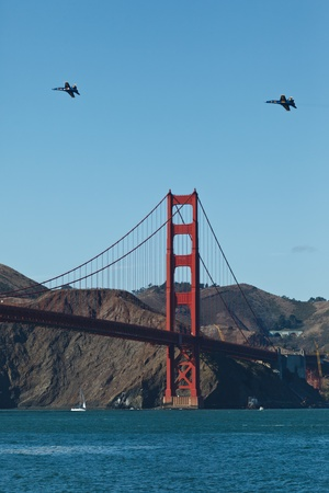 SAN FRANCISCO, CALIFORNIA, USA - October 9, 2011: 2 Fighter Jets Circle Over the Golden Gate Bridge during Fleet Week Airshow in SAN FRANCISCO, CALIFORNIA, USA on October 9, 2011.