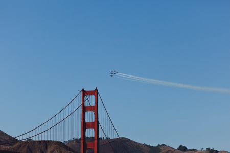 SAN FRANCISCO, CALIFORNIA, USA - October 9, 2011: A  Formation of 6 Fighter Jets  Leaving Vapor Trails Flying Above the Golden Gate Bridge During Fleet Week Airshow in SAN FRANCISCO, CALIFORNIA, USA on October 9, 2011.