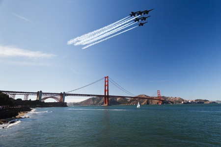 SAN FRANCISCO, CALIFORNIA, USA - October 9, 2011: 6 Fighter jets leave vapor trail as they fly over the Golden Gate Bridge in precision delta wing formation in SAN FRANCISCO, CALIFORNIA, USA on October 9, 2011. Editorial