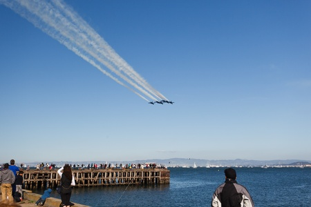 SAN FRANCISCO, CALIFORNIA, USA - October 9, 2011: 6 Fighter jets leave vapor trail as they fly over San Francisco Bay in precision delta wing formation in SAN FRANCISCO, CALIFORNIA, USA on October 9, 2011.