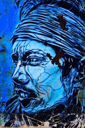 ESSAOUIRA, MOROCCO- JANUARY 13, 2010: Graffiti portrait of Berber man on wall in city on January 13, 2010 in Essaouira, Morocco