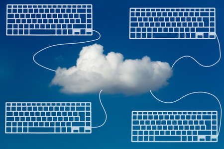 hooked up: White Cloud in blue sky with Laptops hooked up representing Cloud Computing Stock Photo