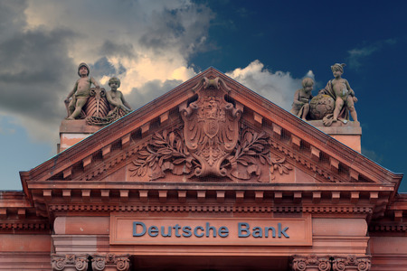 ag: Deutsche Bank in Bremen, Germany (editorial) with dark clouds on the horizon
