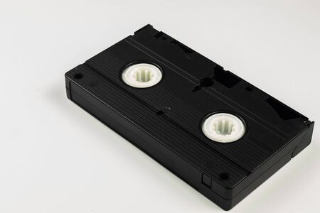 On the table with a white background lies an inverted video cassette.