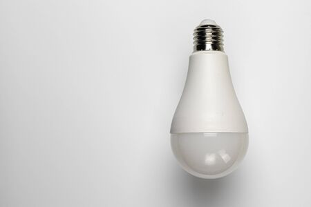 A diode incandescent bulb on white with a place to insert text. The concept of electricity and ecology.