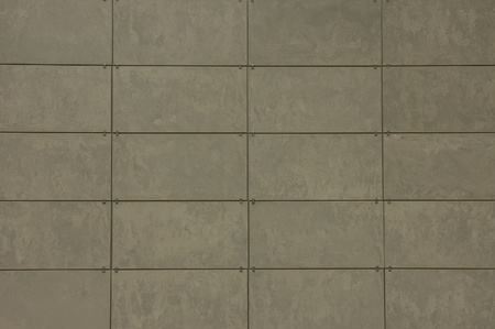cladding tile: A background with a wall made of a pattern of gray tiles