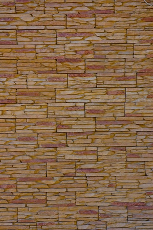The wall of a thin, colored,  broken  stone Stock Photo - 13506246