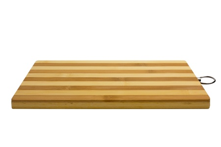 Bamboo cutting board, striped  Isolated on white background photo
