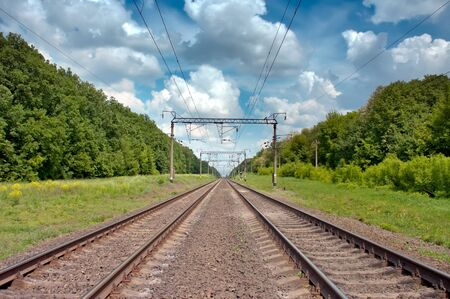 Railroad tracks in the blue sky and clouds Stock Photo - 16783530