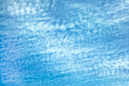 Blue sky background  with white fluffy clouds photo