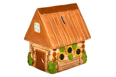 Miniature model country home  piggy bank , ceramic  Ukrainian ethnic motive  Isolated on white background photo