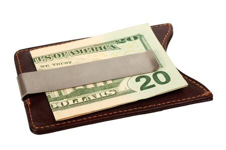 Dollars in brown leather money clip  Isolated on white background, saved with clipping path  photo