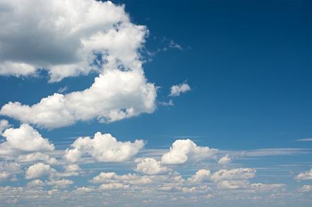saturated: Cumulus clouds against a bright blue sky saturated.