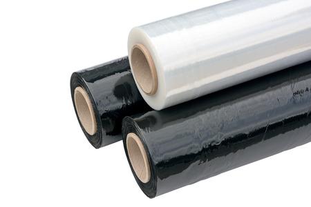 roll film: Tres rollos de embalaje film estirable negro y transparente. Envolver pel�cula. Aislado en el fondo blanco. Foto de archivo