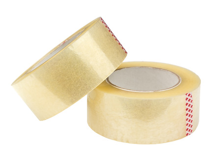 Two rolls of adhesive tape. Isolated on white background. Clipping path is saved.