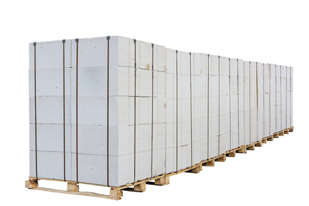 Concrete (aerated concrete) blocks on the pallet. Isolated on white background. Clipping path is saved. Reklamní fotografie - 37615300